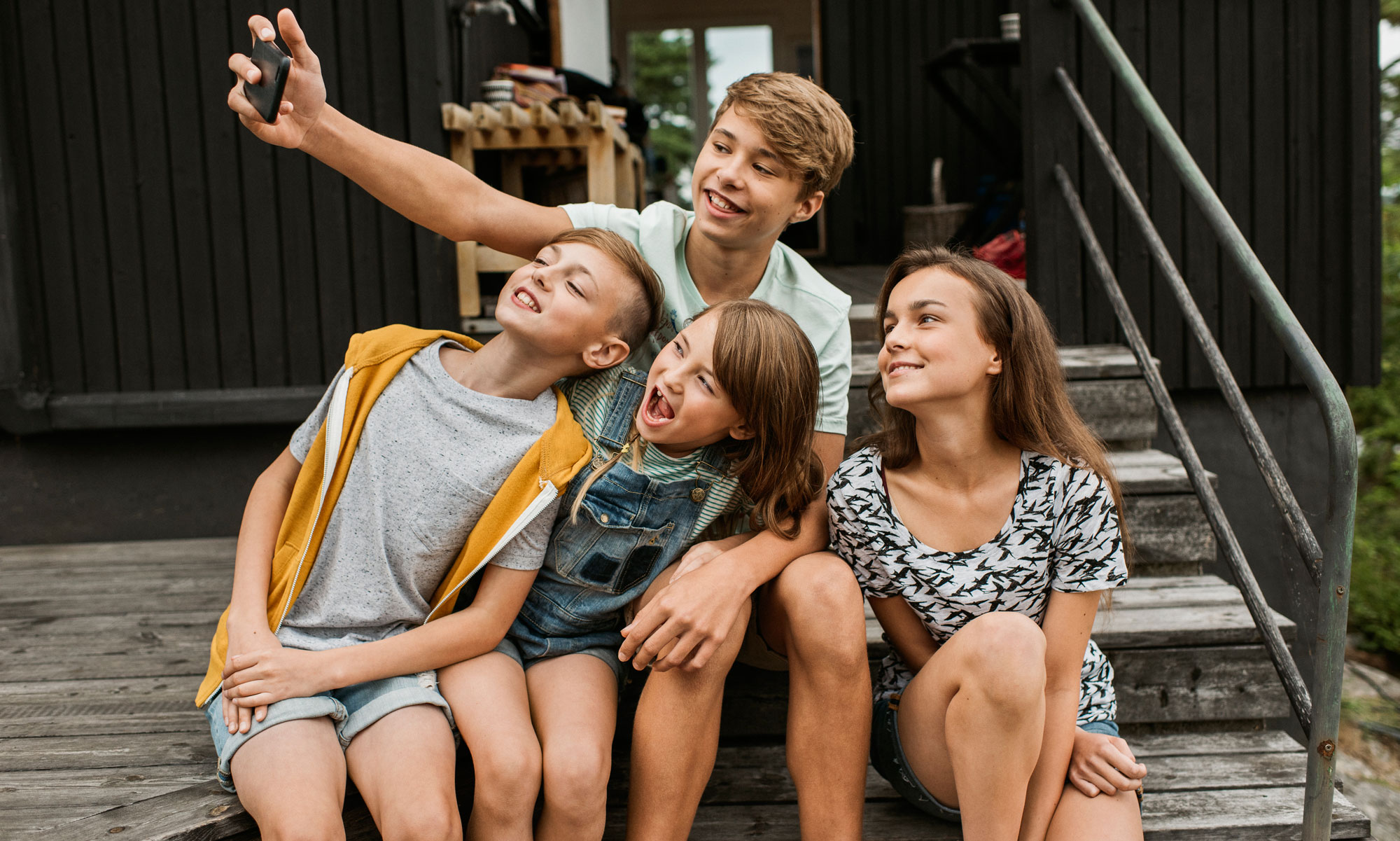 Kids taking group selfie on terrace